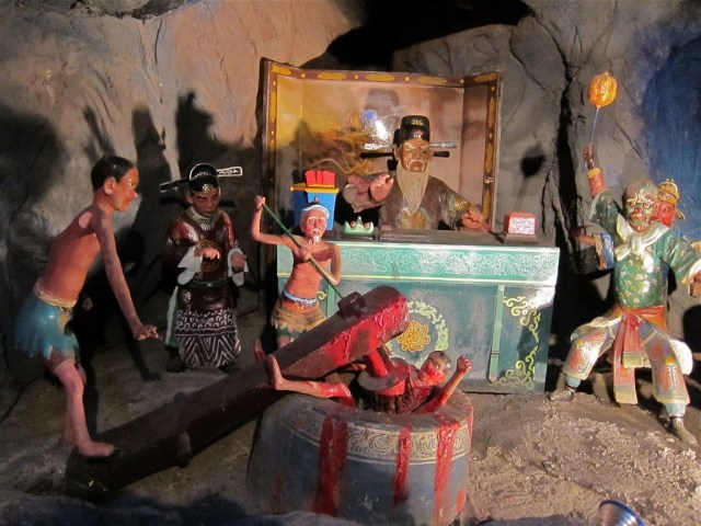 One of the courts of hell at Haw Par Villa | curlytraveller.com