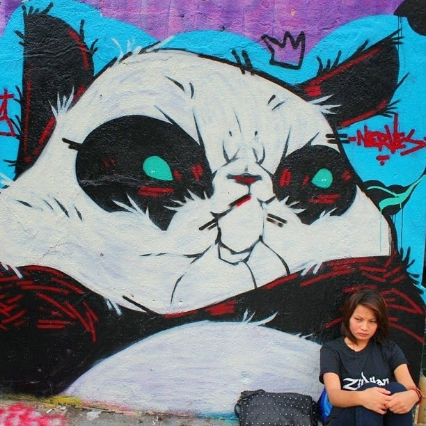 Street art and a grumpy girl in Manilla.