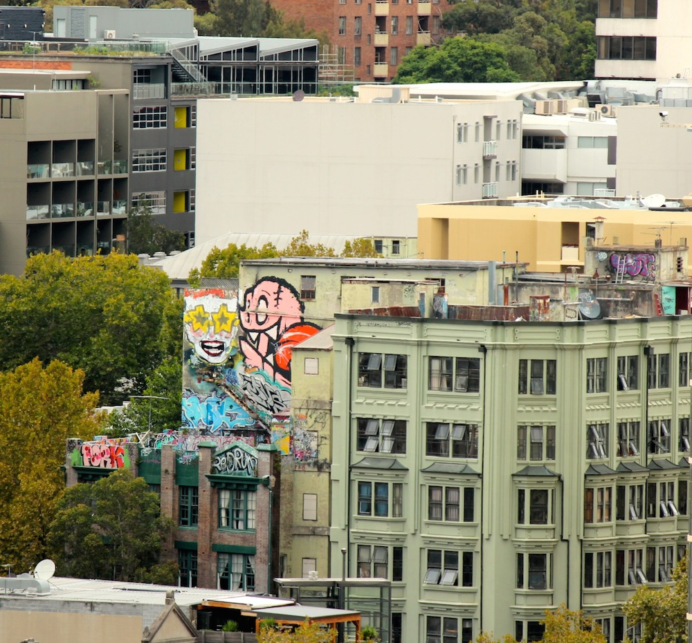 mural high up on a building in Sydney|curlytraveller.com