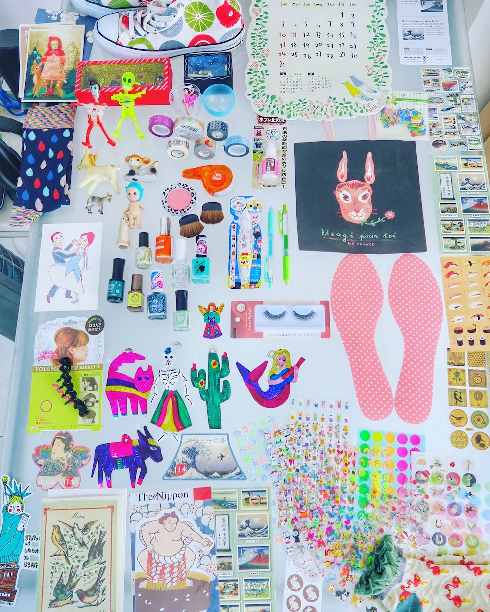 Table full of small purchases made in Tokyo |curlytraveller.com