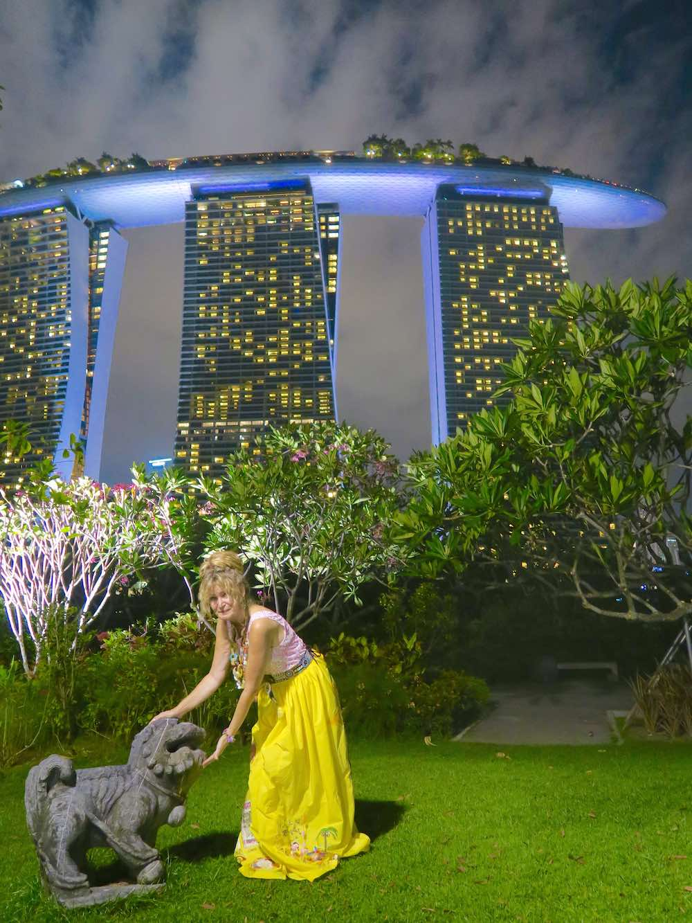 Woman pets a stone lion in Singapore's Gardens by the Bay |curlytraveller.com