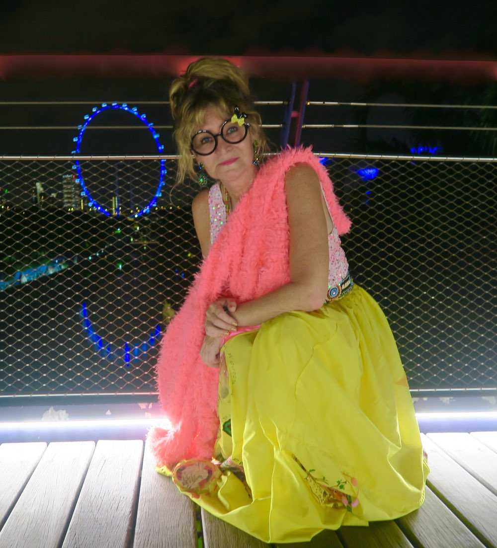 Woman in yellow skirt and hot pink faux fur |curlytraveller.com