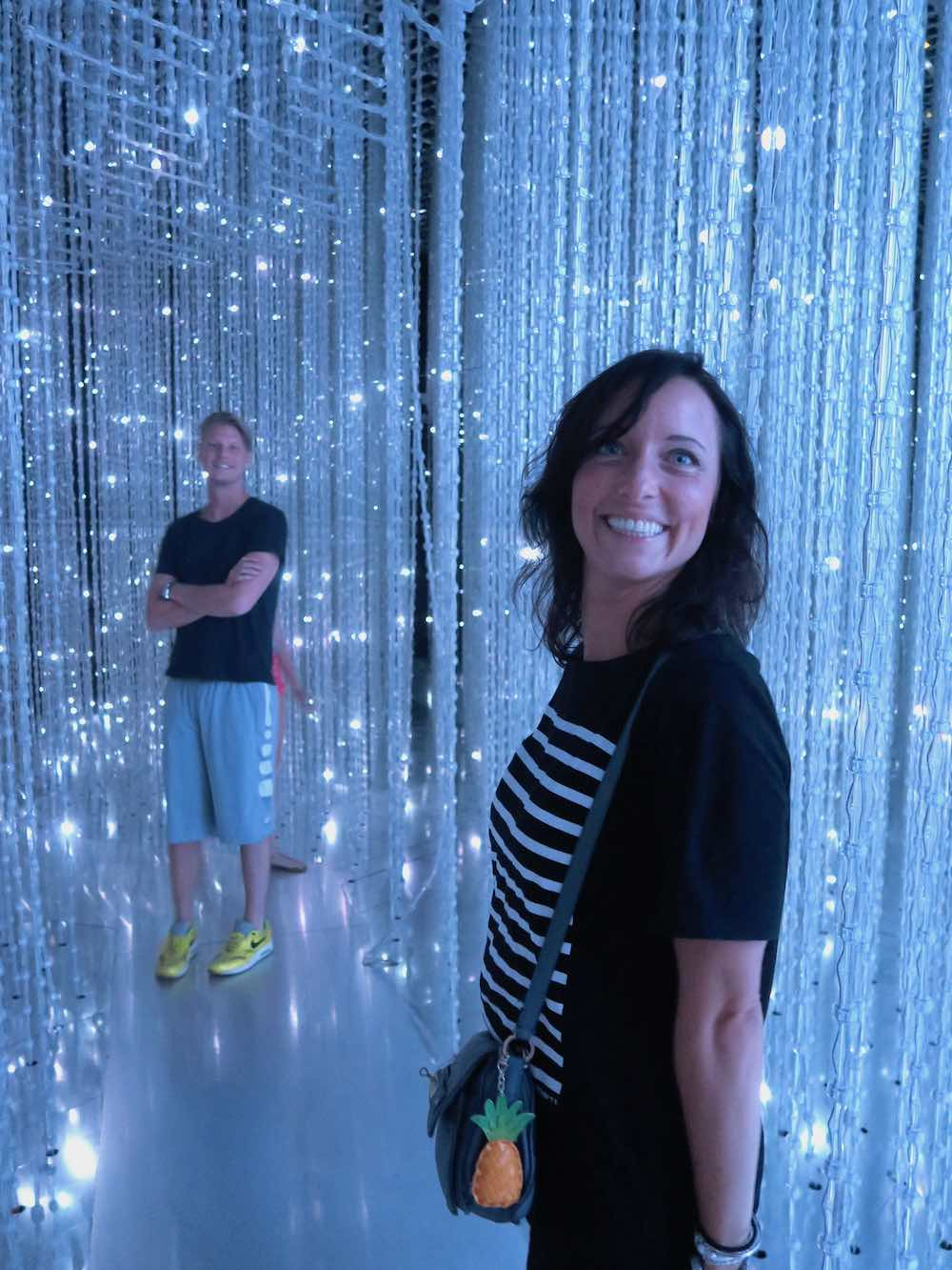 Young couple having fun in Crystal Universe Singapore |curlytraveller.com