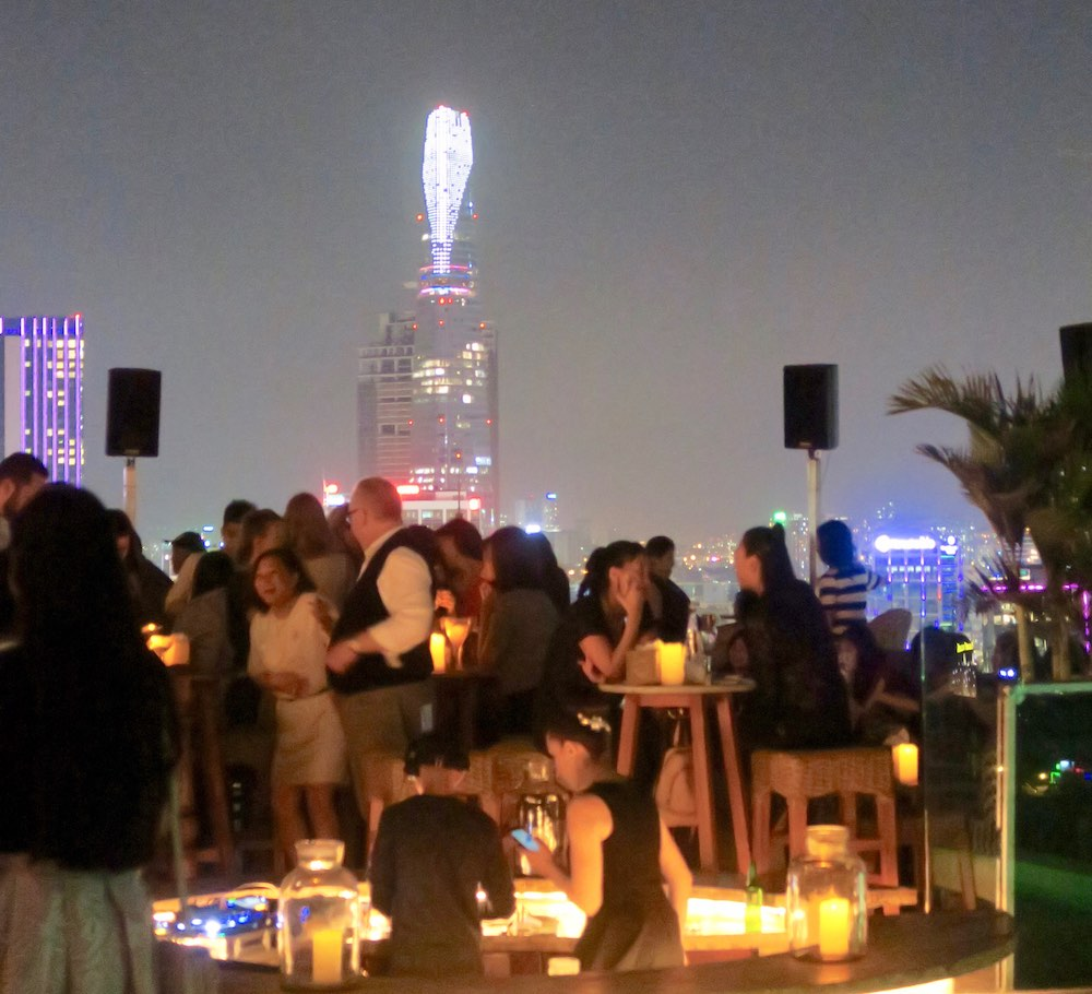Young people clubbing at the rooftop of Hotel des Arts Saigon |curlytraveller.com