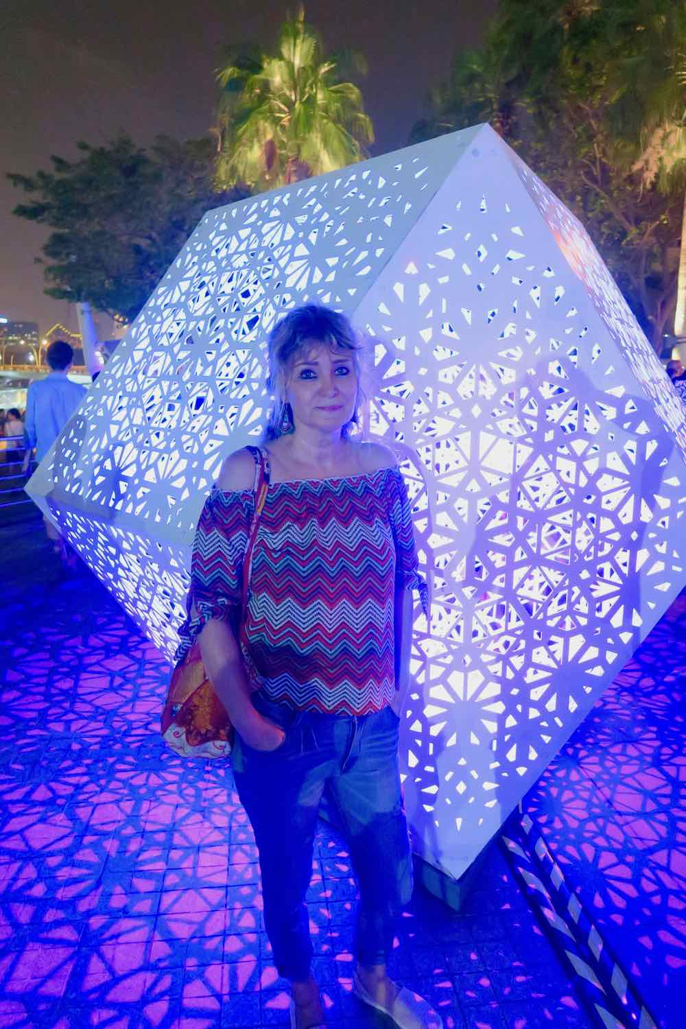 Woman in front of pretty lit cubes at iLightMarina Bay Singapore |curlytraveller.com