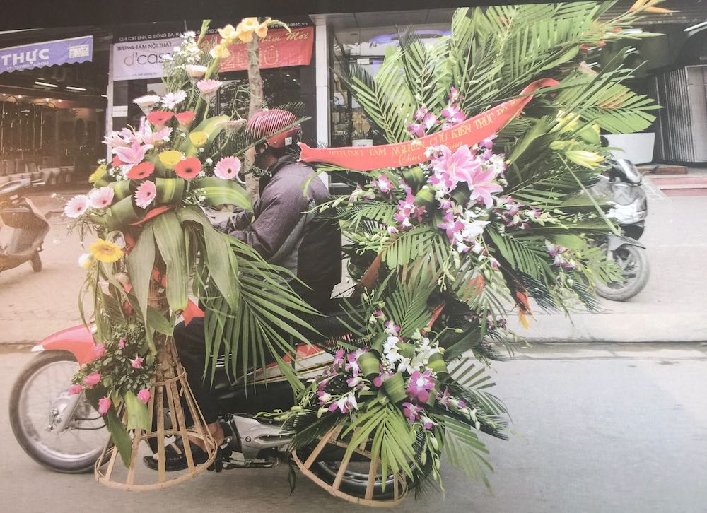 Bike loaded with huge flower arrangements |curlytraveller.com