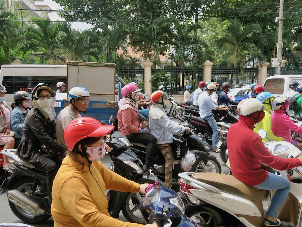 Street filled with motorbikes in Saigon |curlytraveller.com