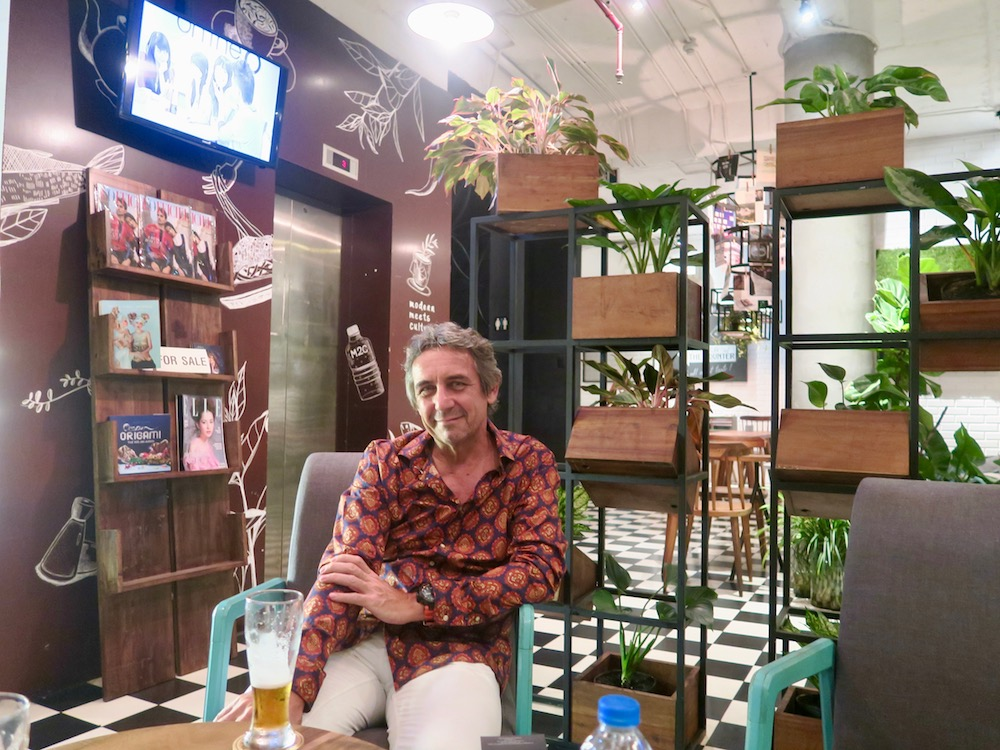 Man sitting in MC2 Cafe in Saigon |curlytraveller.com