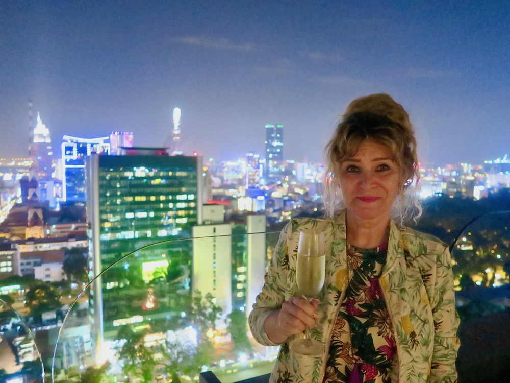 Woman drinking champagne on rooftop bar Sri in Saigon |curlytraveller.com