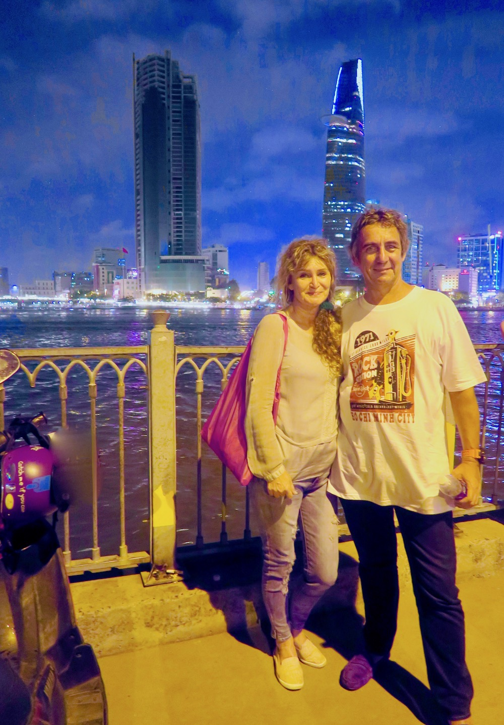 Couple in front of Saigon River |curlytraveller.com