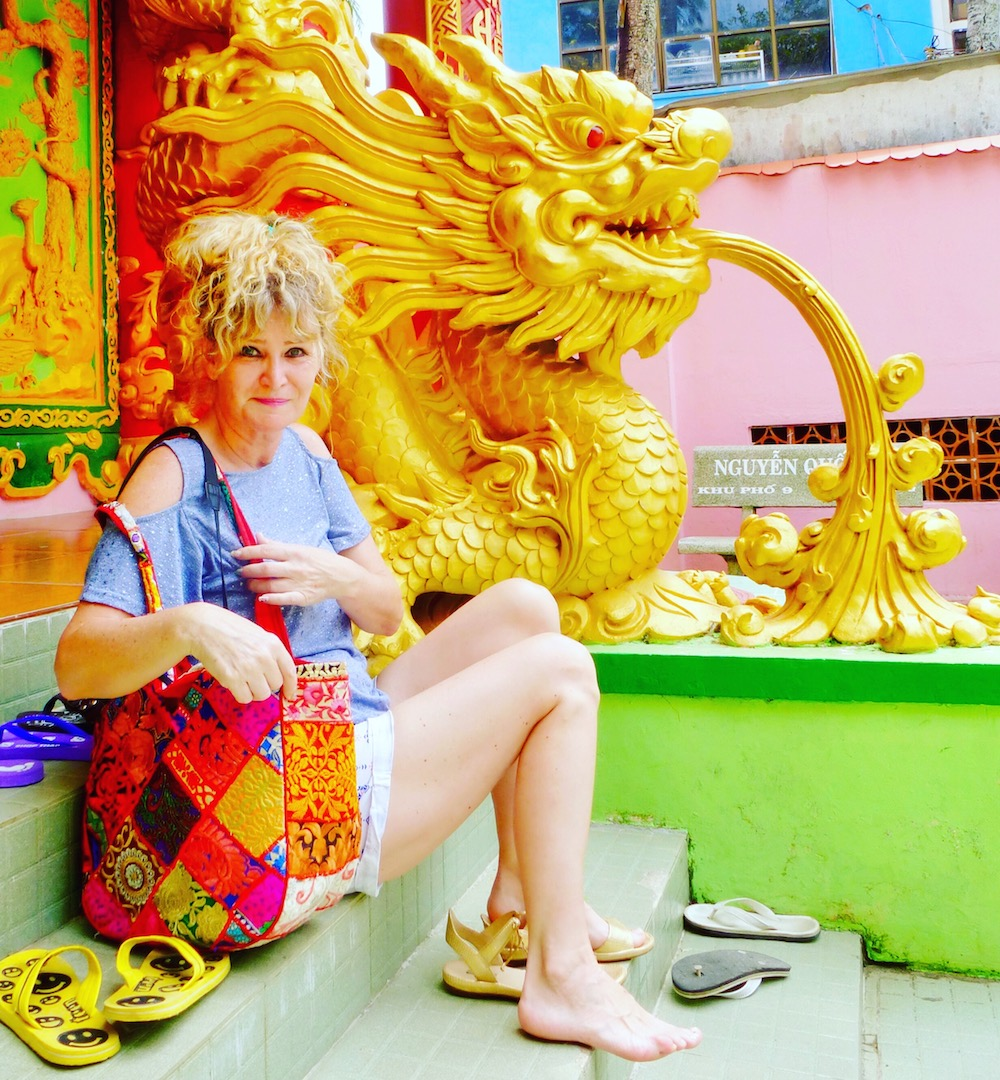 Woman sitting in front of temple on Phu Quoc island |curlytraveller.com