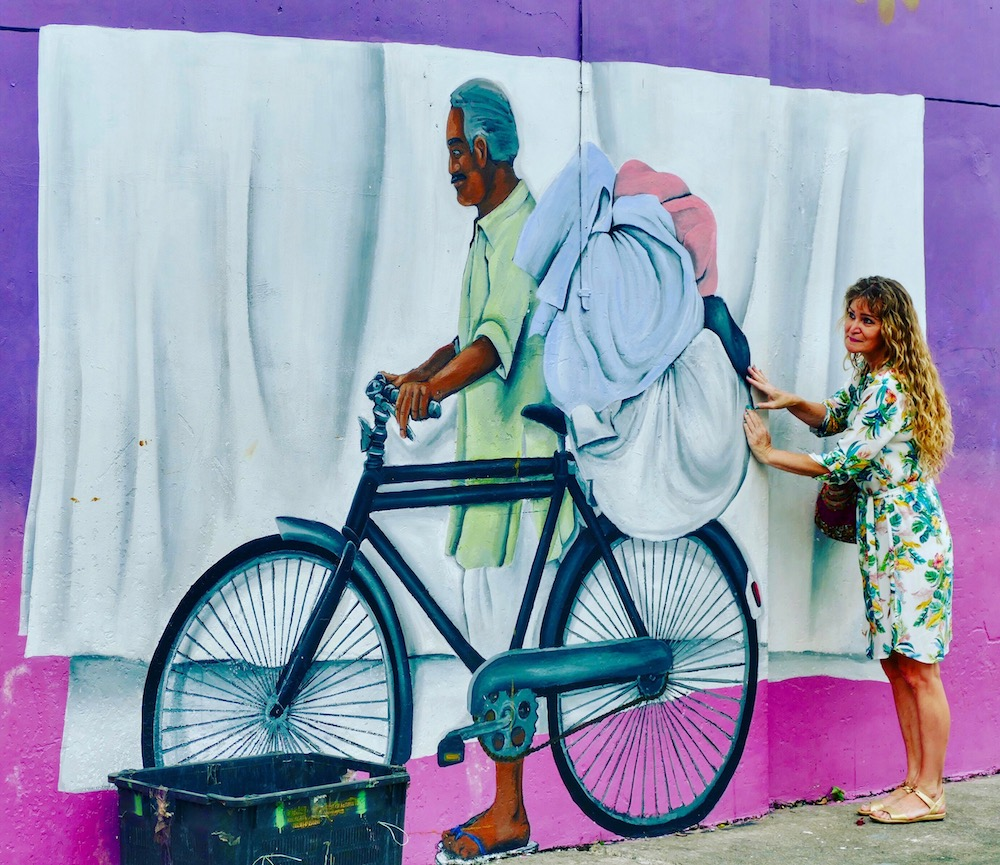 Woman in front of a giant mural in Little India |curlytraveller.com