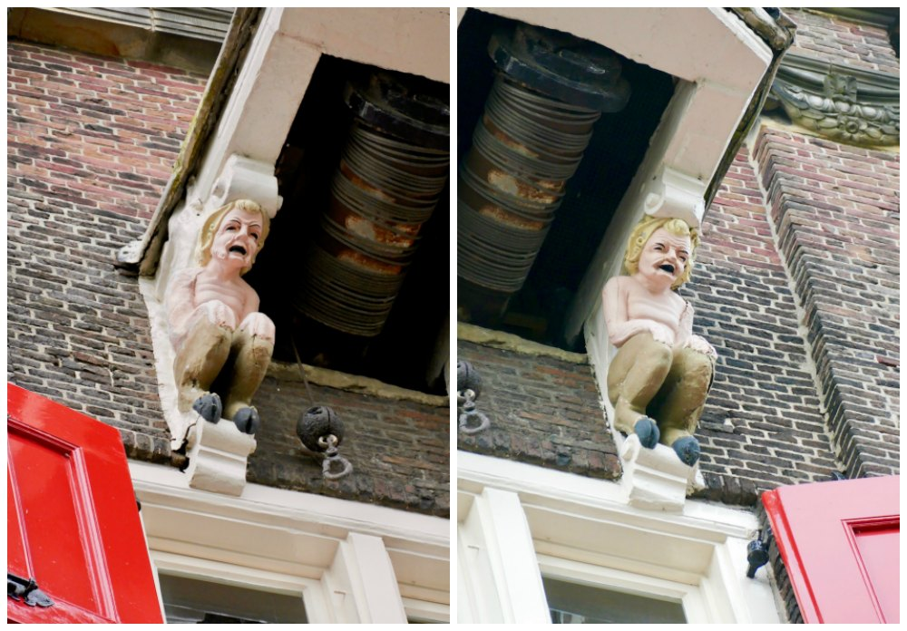 Two saters as ornaments on a monumental warehouse in Dordrecht |curlytraveller.com