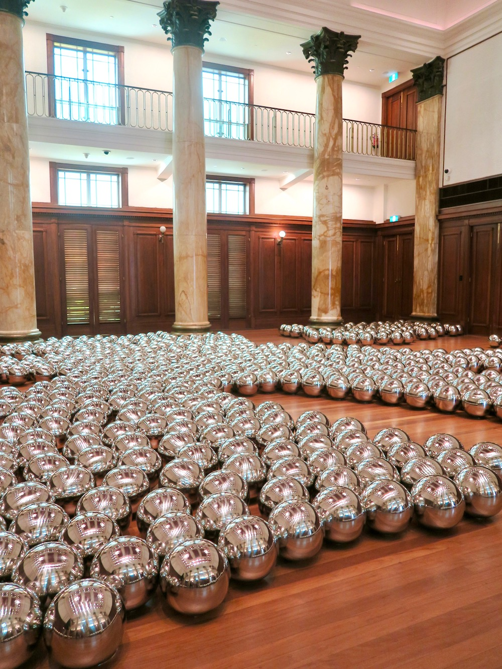 Silver balls lying on the floor in a class room |curlytraveller.com