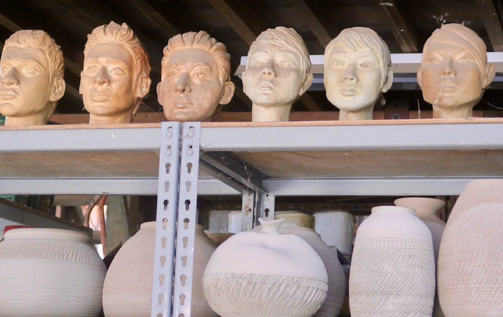 Clay heads at a pottery in Singapore |curlytraveller.com