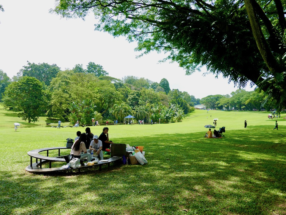 People sitting on a bench in the Istana gardens |curlytraveller.com