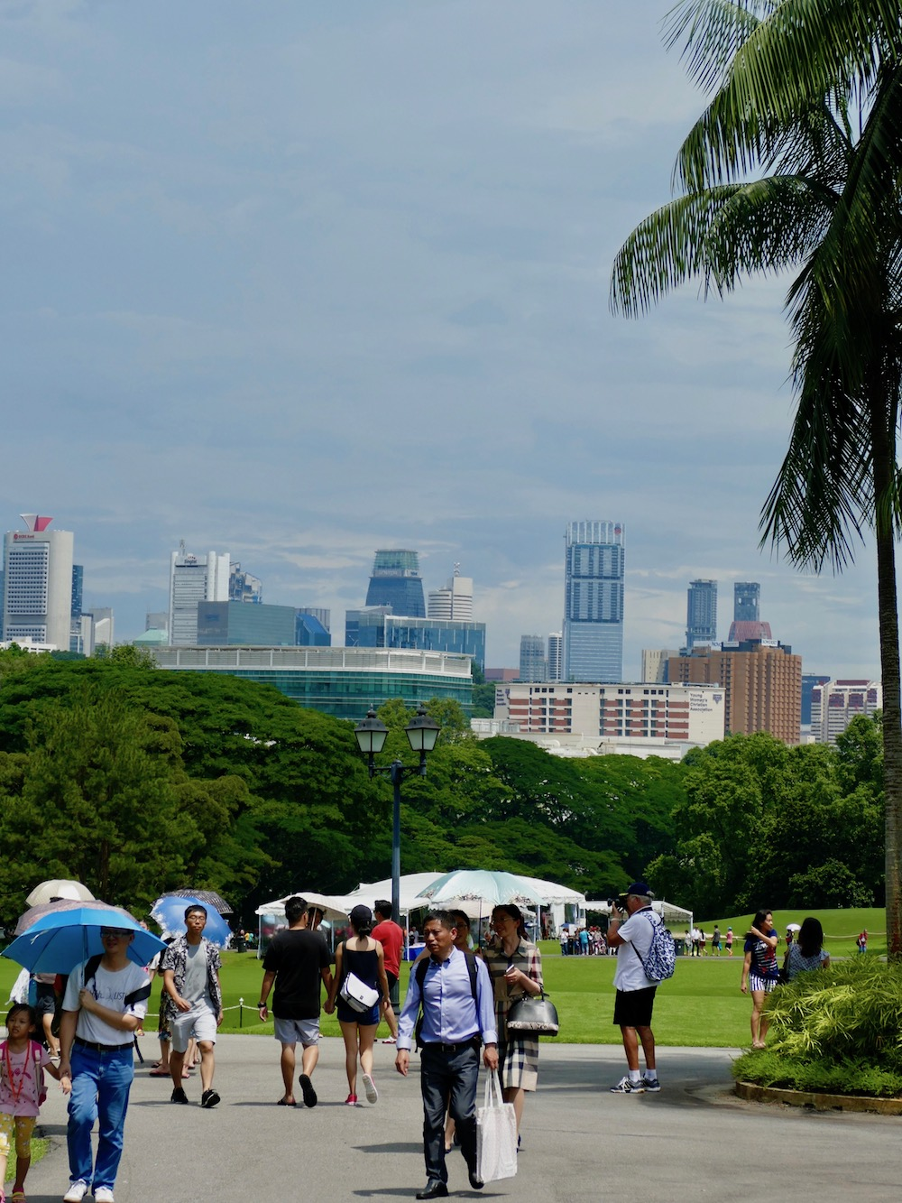 People strolling around at the Istana grounds in Singapore |curlytraveller.com