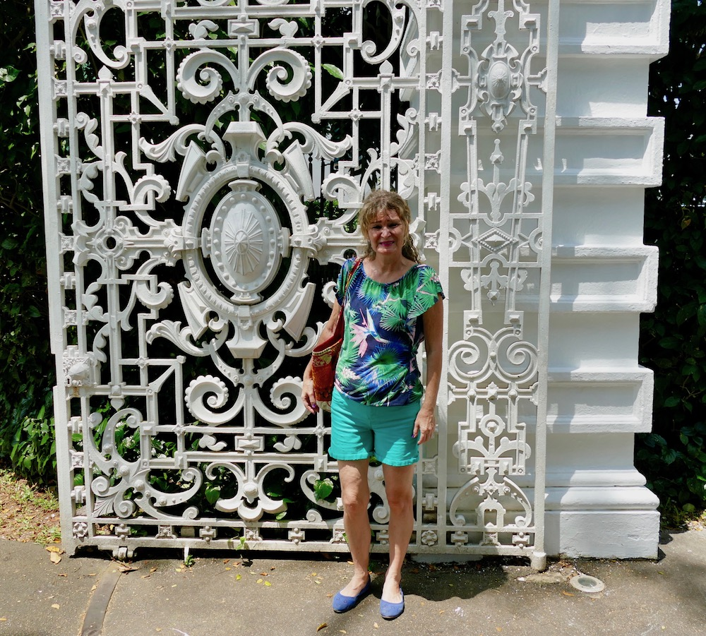 Woman in front of Istana gate |curlytraveller.com