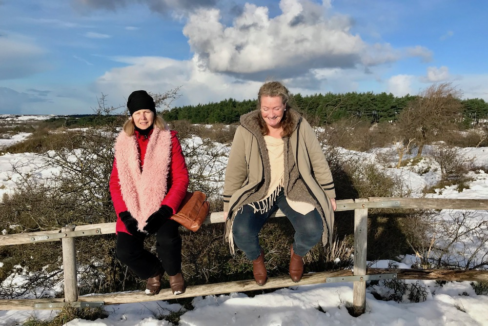Two women on top of a dune |curlytraveller.com