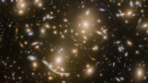 Hubble Space Telescope Captures Galaxy Cluster 6 Billion Light Years Away