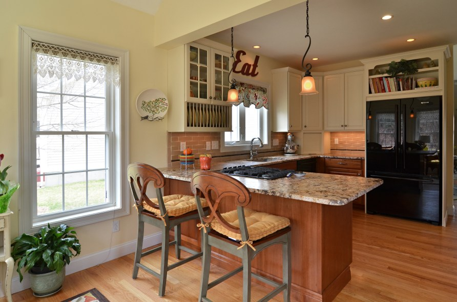 Combine small kitchen and sun room to create a spacious ...
