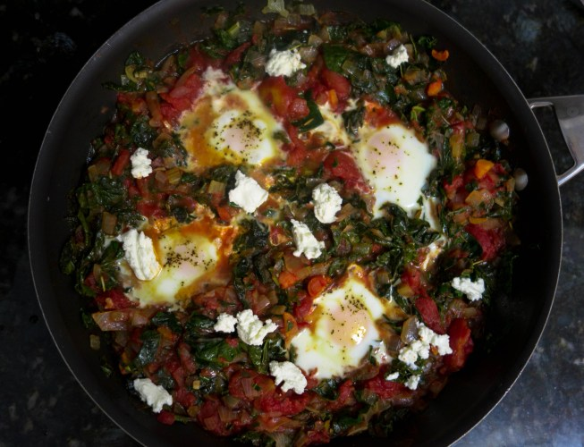 kale and tomato stew with eggs