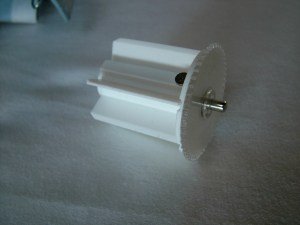 Spring Loaded pin with knurled retraction wheel.