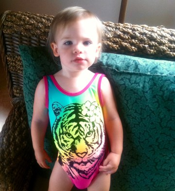 Fenna loves her new swim suit and can't stop roar-ing when she wears it.