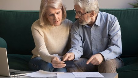 Older married couple dealing with financial trouble