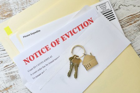 eviction letter with house keys on top