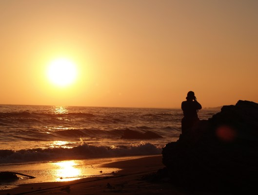 Sunset and fellow photographer at the beach