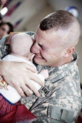 image photo military father hugging infant child may 2016