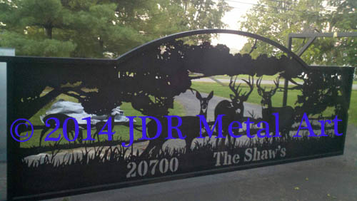 Front entry gate with deer wildlife silhouettes made with a plasma cutter.