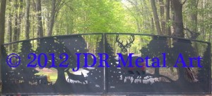 Custom driveway gates featuring steel cutouts of deer fox and trees plasma cut by JDR Metal Art.