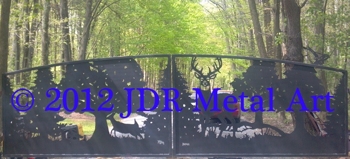 Rustic driveway gates featuring cutouts of deer fox and trees plasma cut by JDR Metal Art.