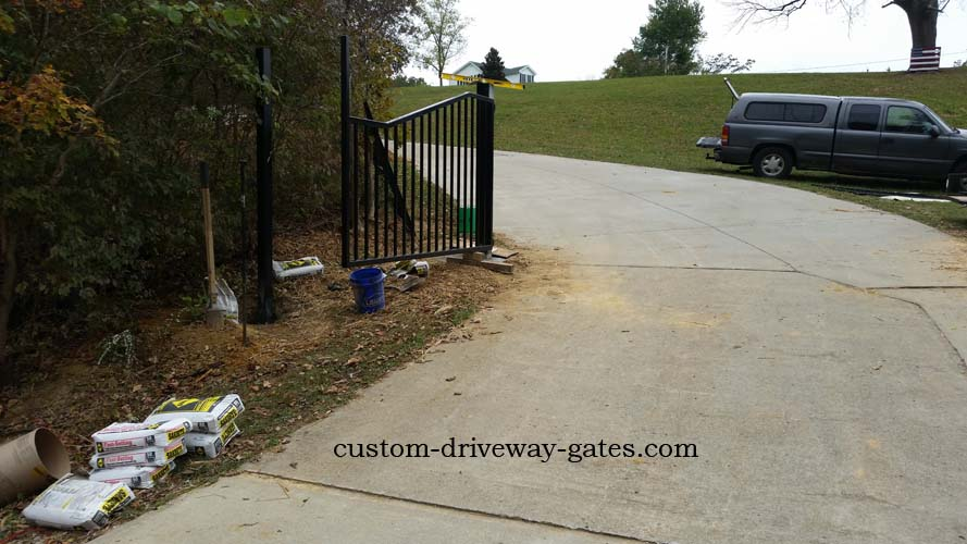Installing Louisville driveway gates and fence posts.