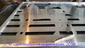 Aluminum driveway gate with design of horses for home in Los Angeles.