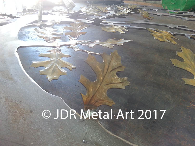 Metal oak tree with custom leaves.