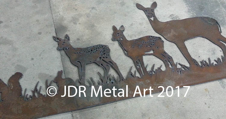 Steel plasma cut doe and fawn silhouettes for driveway gate.
