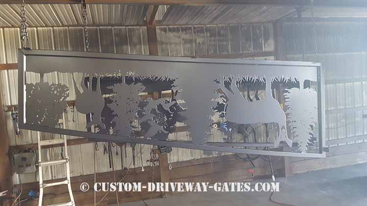 Black powder coated fence panel plasma cut from steel with a 2x2 square tubing frame.