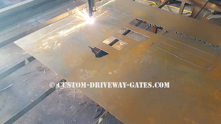 Indianapolis driveway gate panel being plasma cut into metal art horses from an 1/8