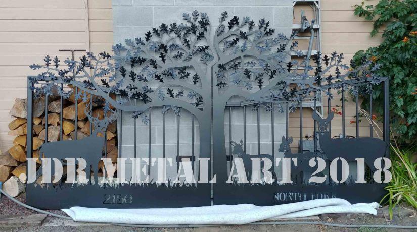 Metal gates with tree for Washington home.