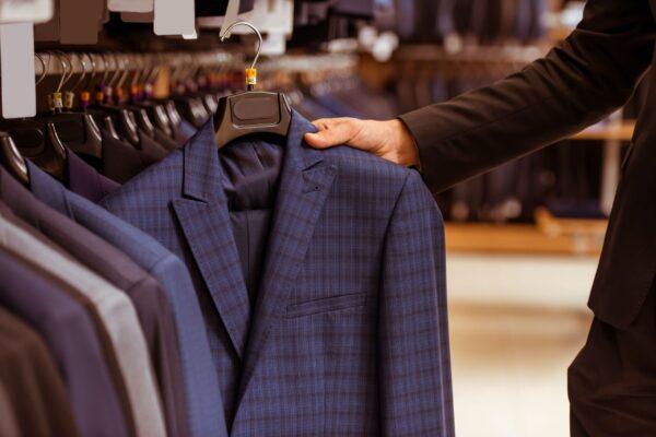 handsome-businessman-choosing-classical-suit