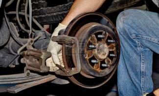 45137602-mechanic-changing-brake-pads-on-a-car