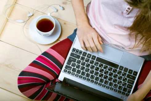 Teen girl sitting with a laptop