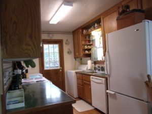 The Bottom Freezer & huge refrigerator will hold lots of meals & snacks inside The Beaver Lake Vacation Cabin!
