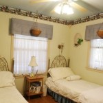 Grab a book and escape to the Cottage Garden Bedroom In Vacation Cabin on Beaver Lake