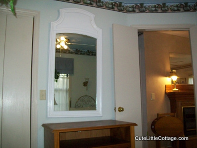Big mirrors make getting ready to go out easier in Cottage Garden Bedroom In Vacation Cabin on Beaver Lake