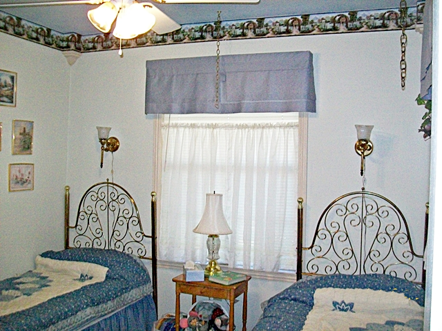 Different comforters in the Cottage Garden Bedroom In Vacation Cabin on Beaver Lake