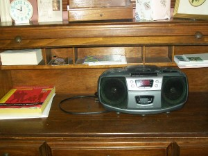 CD player in roll-top desk in the Coin Harvey Bedroom Beaver Lake Vacation Rental